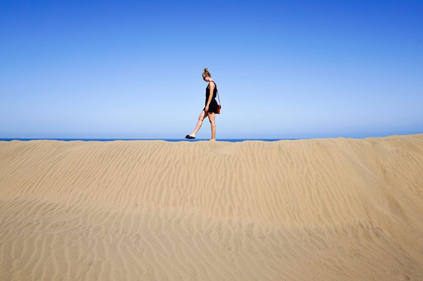 man walking on sandune